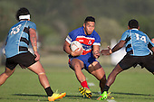 Joseph Ikenasio takes on Omopene Tuaia and Tolovau Ape during the Counties Manukau Premier Club Rugby game between Ardmore Marist and Weymouth, played at Bruce Pulman Park on May 14th 2016. Ardmore Marist won the game 43 - 7 after leading 17 - 0 at halftime. Photo by Richard Spranger.