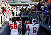Ohio State Buckeyes wide receiver Michael Thomas (83) throws a rose to Michigan fans as the team walks off the field after the college football game between the Ohio State Buckeyes and the Michigan Wolverines at Michigan Stadium in Ann Arbor, Michigan, Saturday afternoon, November 30, 2013. The Ohio State Buckeyes defeated the Michigan Wolverines 42 - 41. (The Columbus Dispatch / Eamon Queeney)