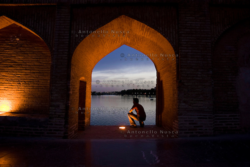 A man at the Si-o-Seh Pol bridge (Bridge of 33 Arches) in Isfahan.