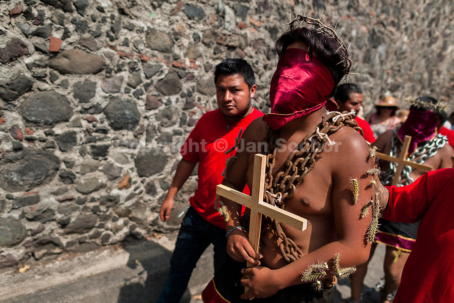 A hooded Catholic penitent, wearing chains and cactus spines stuck to his body, takes part in the Holy week procession in Atlixco, Mexico, 30 March 2018. Every year on Good Friday, dozens of anonymous men of all ages voluntarily undergo pain and suffering during the religious procession of the 'Engrillados' (the Shackled ones) in Puebla state, central Mexico. Wearing heavy chains on their shoulders covered with prickling cacti while being burned by the hot midday sun, they recall Jesus Christ's death by crucifixion and demonstrate their religiosity and faith.
