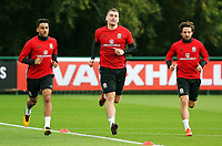 Pictured: (L-R) Neil Taylor, Sam Vokes and Joe Allen run on the pitch. Monday 02 October 2017<br />Re: Wales football training, ahead of their FIFA Word Cup 2018 qualifier against Georgia, Vale Resort, near Cardiff, Wales, UK.