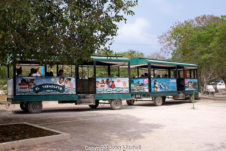 Tourist train at the Mayan ruins of Tulum on the Riviera Maya, Quintana Roo, Mexico.