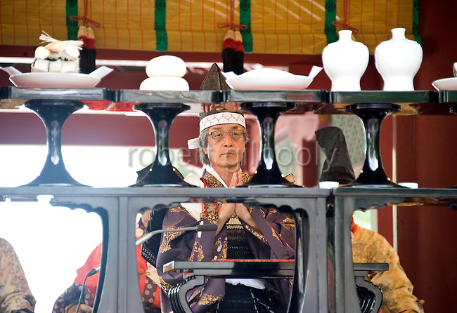 A horseback archer dressed in samurai garb attends a ritual during the annual Reitaisai Grand Festival at Tsurugaoka Hachimangu Shrine in Kamakura, Japan on  14 Sept. 2012.  Sept 14 marks the first day of the 3-day Reitaisai festival, which starts early in the morning when shrine priests and officials perform a purification ritual in the ocean during a rite known as hamaorisai and limaxes with a display of yabusame horseback archery. Photographer: Robert Gilhooly