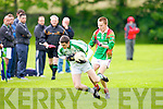 St Brendan's Trevor Wallace gets to the ball ahead of St Micheal's/Foilmore Darran O'Sullivan in the Kerry senior football championship at Blennerville on Saturday.