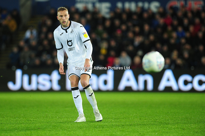 Mike van der Hoorn of Swansea City in action during the Sky Bet Championship match between Swansea City and Millwall at the Liberty Stadium in Swansea, Wales, UK. Saturday 23rd November 2019