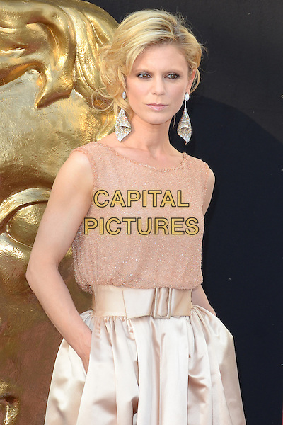 Emilia Fox.Arqiva British Academy Television Awards at the Royal Festival Hall, London, England..May 27th 2012.BAFTA BAFTAS half length pink beige skirt sleeveless top silk satin hands in pockets silver earrings .CAP/PP/JB.©Jane Burrows/PP/Capital Pictures.