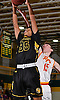 Tyrone Lyons #35 of St. Anthony's, left, grabs a rebound during the Nassau-Suffolk CHSAA varsity boys basketball semifinals against Chaminade at LIU Post on Sunday, Feb. 26, 2017. Chaminade won by a score of 66-50.