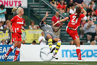 Philadelphia Independence forward, Natasha Kai (00), gets flattened by Western New York Flash midfielder, Brittany Bock (21).  The Western New York Flash won the WPS Championship on penalty kicks, after finishing regulation time and two 15-minute overtimes with the score knotted at 1-1.  The game was played at Sahlen's Stadium on Aug 27th in Rochester, NY.
