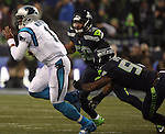 Seattle Seahawks  linebacker Bruce Irvin (51)) lunges for Carolina Panthers quarterback Kam Newton (2) during the NFC Western Division Playoffs at CenturyLink Field  on January 10, 2015 in Seattle, Washington. The Seahawks beat the Panthers 31-17. ©2015. Jim Bryant Photo. All Rights Reserved.