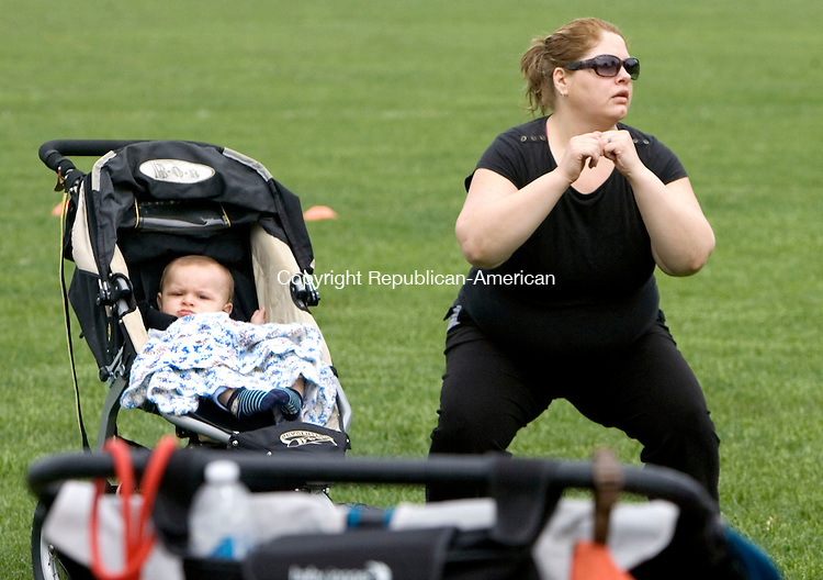 MIDDLEBURY CT. 19 May 2015-052115SV02-Johnna Granton and her baby JJ Granton, 8 months, of Naugatuck participate in a stroller boot camp for women with their babies at Meadowview Park in Middlebury Thursday. The class is sponsored by the Parks and Recreation Department.<br /> Steven Valenti Republican-American
