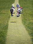 JEJU, SOUTH KOREA - APRIL 24:  Lam Chih-bing of Singapore, Pablo Larrazabal of Spain, Anthony Kim of USA and their caddies walk on the 13th hole during the Round Two of the Ballantine's Championship at Pinx Golf Club on April 24, 2010 in Jeju island, South Korea. Photo by Victor Fraile / The Power of Sport Images