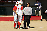 MADISON, WI - APRIL 16: Head coach Chandelle Schulte of the Wisconsin Badgers softball team talks to her players against the Indiana Hoosiers at Goodman Diamond on April 16, 2007 in Madison, Wisconsin. (Photo by David Stluka)