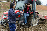Tour leader Etsuko Nakamura after having a go at ploughing a rice paddy for growing sake rice. Marumoto Sake Brewery, Asakuchi city, Okayama Pref, Japan, January 28, 2014. Okayama is famous for its earthy full-bodied sake. In January and February 2014 a 5-day tour of breweries in the prefecture was organised by Sake Brewery Tours (www.saketours.com).