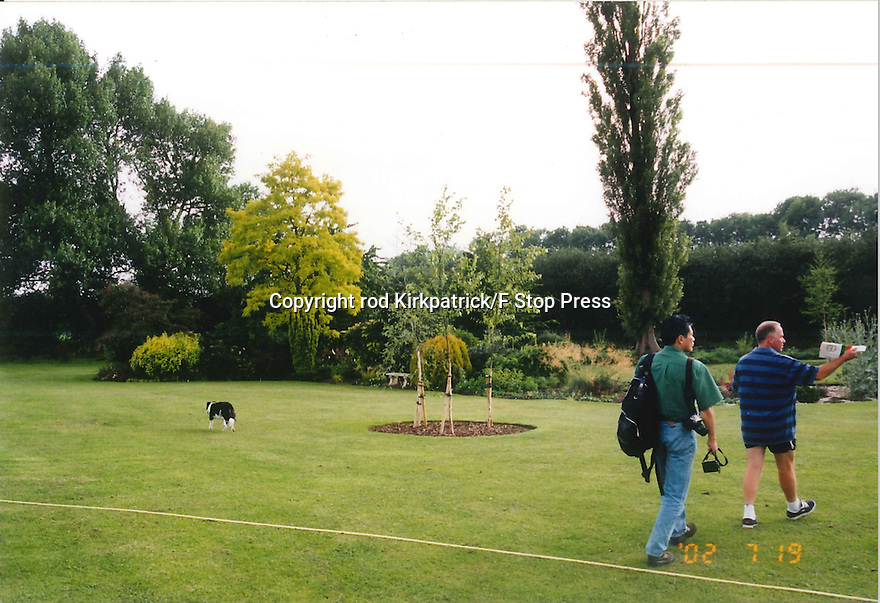 Collect photo from 2002.<br /> <br /> Visitors look around John's garden shortly after birch trees  were planted in circular bed. <br /> <br /> All Rights Reserved: F Stop Press Ltd. +44(0)1773 550665   www.fstoppress.com 27/10/16<br /> <br /> You'd be forgiven for thinking that after more than 50 years running a garden nursery, 67-year-old John Massey would be enjoying the peace and tranquillity of retirement.<br /> <br /> But not a bit of it, if anything this keen plantsman is now busier than ever, caring for his own three-acre garden, a beautiful 'all seasons' oasis set in the heart of industrial Birmingham.<br /> <br /> Full story: https://fstoppressblog.wordpress.com/birmingham-garden-in-stunning-autumn-colour/<br /> <br /> With its informal borders, island beds, woodland dells and wildlife meadow, the garden is a riot of colour still, despite the colder evenings and fading daylight hours, showing off an abundance of rare plants as well as many familiar favourites including cyclamen and colchicums, malus trees laden with crab apples and the fiery hues of liquidambar, euonymus and Japanese acers.<br /> <br /> MORE…<br /> <br /> All Rights Reserved: F Stop Press Ltd. +44(0)1773 550665 www.fstoppress.com