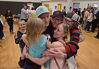 NWA Democrat-Gazette/BEN GOFF @NWABENGOFF<br /> Casey Sparks (from left), holding daughter Emerald Sparks, 3, joins his siblings Chad Sparks, Samantha Sparks and Charley Sparks, all of Bella Vista, in a group hug Friday, May 12, 2017, after Chad Sparks graduated the during the Benton County Adult Drug Court and Veterans Treatment Court graduation at Bentonville Church of Christ.