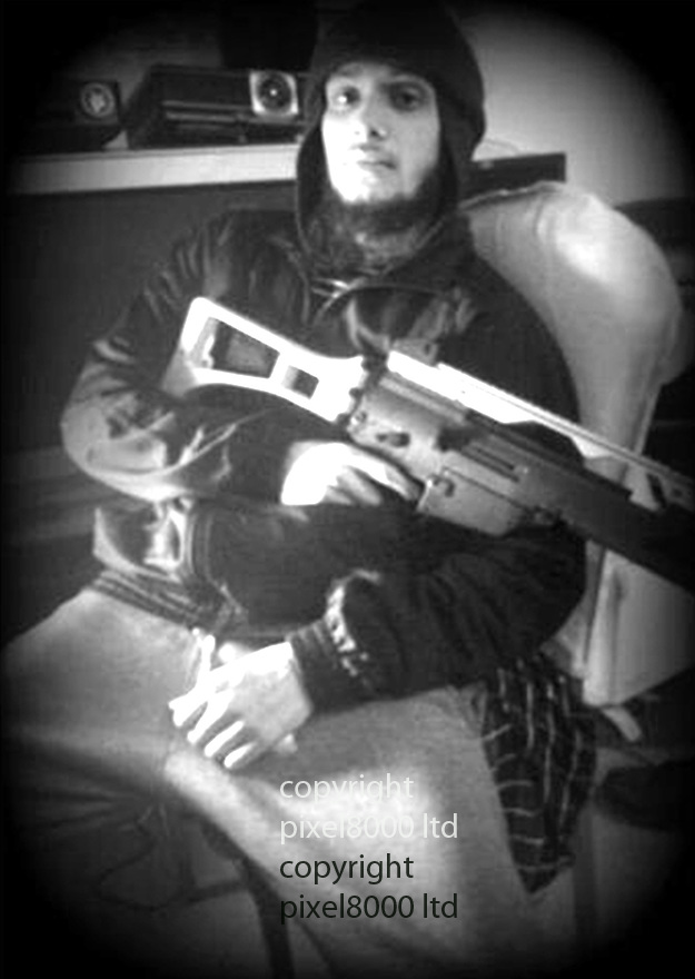 Mohammed Nahin Ahmed and Yusuf Zubair Sarwar admit terror offences<br /> <br /> Pic shows: Nahin Ahmed holding toy gun - pre travel - taken from his computer<br /> <br /> Picture by  Pixel8000 07917221968