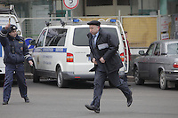 Moscow, Russia, 29/03/2010..Scenes outside Lubyanka metro station, where at least 24 people were killed in a morning rush hour suicide bombing. A second bomb exploded at Park Kultury metro station, killing at least another 14 people. Federal security officer running outside the metro station..