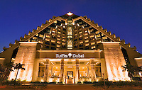 Dubai.  Raffles Hotel built on an Egyptian theme and adjacent to the Wafi Mall, a luxurious shopping centre/center.  Evening..