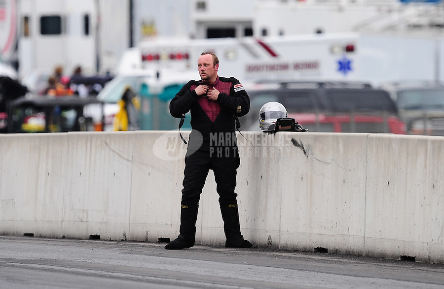 Oct. 1, 2011; Mohnton, PA, USA: NHRA top alcohol dragster driver Jared Dreher after getting a flat tire during qualifying for the Auto Plus Nationals at Maple Grove Raceway. Mandatory Credit: Mark J. Rebilas-