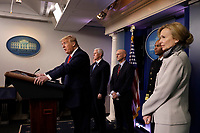 United States President Donald J. Trump speaks during a press briefing on the Coronavirus COVID-19 pandemic with members of the Coronavirus Task Force at the White House in Washington on March 19, 2020.   Standing behind the President, from left to right: US Vice President Mike Pence; Stephen Hahn, Commissioner, US Food and Drug Administration (FDA); US Surgeon General Vice Admiral (VADM) Jerome M. Adams, M.D., M.P.H.; and Dr. Deborah L. Birx, White House Coronavirus Response Coordinator.<br /> Credit: Yuri Gripas / Pool via CNP/AdMedia
