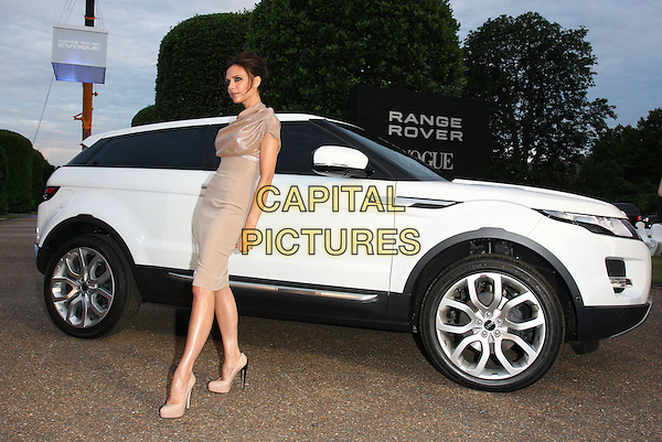 VICTORIA BECKHAM .(wearing Victoria Beckham dress).Attends the Range Rover 40th Anniversary Party in association with Vogue at the Orangery, Kensington Palace, London, England, Uk, .July 1st 2010..full  length beige gold shimmery shiny sparkly ruched top high waisted waist skirt nude shoes heels platform asymmetric new car model white vehicle posing .CAP/ROS.©Steve Ross/Capital Pictures.