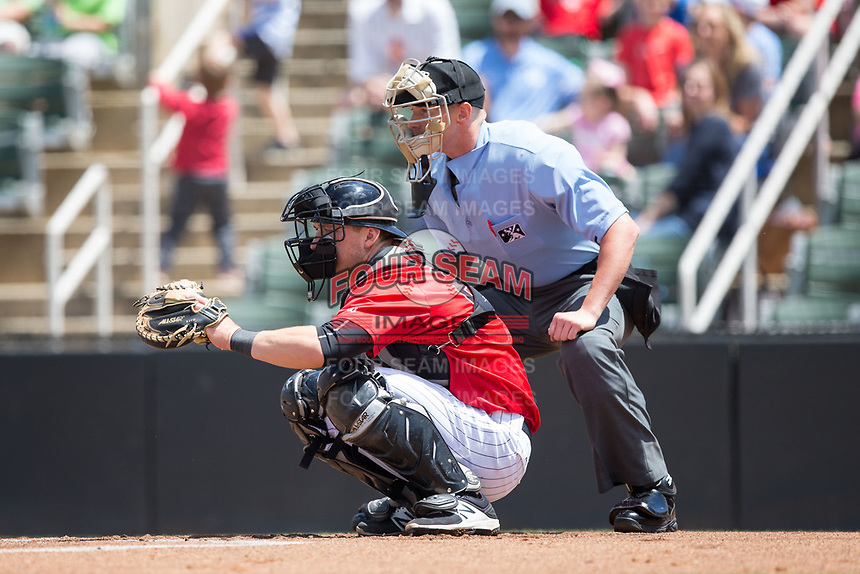 Kannapolis Intimidators catcher Nate Nolan (22) sets a target as home plate umpire Mike Snover looks on during the game against the Asheville Tourists at Kannapolis Intimidators Stadium on May 7, 2017 in Kannapolis, North Carolina.  The Tourists defeated the Intimidators 4-1.  (Brian Westerholt/Four Seam Images)
