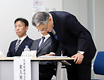 August 9, 2017, Tokyo, Japan - Japan Display chairman and CEO Nobuhiro Higashiiriki bows his head as he announces the company's business strategy in Tokyo on Wednesday, August 9 2017. Japan Display announced to cut 3,700 jobs mostly overseas to restruct its business.  (Photo by Yoshio Tsunoda/AFLO) LwX -ytd-