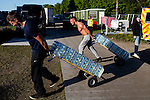 © Joel Goodman - 07973 332324 . 07/06/2015 . Manchester , UK . Carrying water at The Parklife 2015 music festival in Heaton Park , Manchester . Photo credit : Joel Goodman
