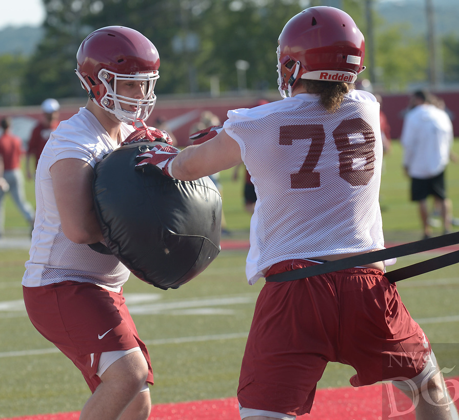 NWA Democrat-Gazette/ANDY SHUPE<br /> Arkansas offensive linemen Dalton Wagner (78) and Noah Gatlin (73) participate in a drill Friday, Aug. 3, 2018, during practice at the university practice field on campus in Fayetteville. Visit nwadg.com/photos to see more photographs from the practice.