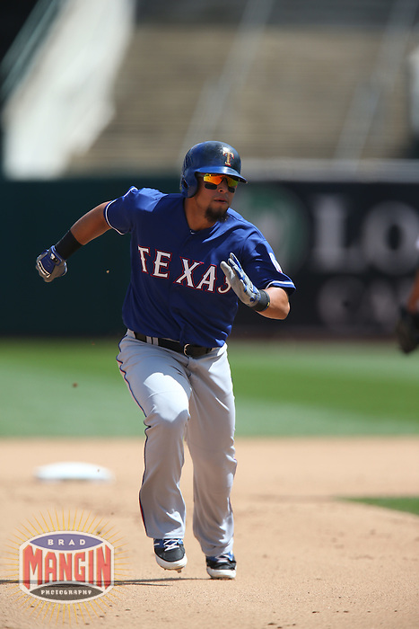 OAKLAND, CA - APRIL 9:  Rougned Odor #12 of the Texas Rangers runs the bases against the Oakland Athletics during the game at O.co Coliseum on Thursday, April 9, 2015 in Oakland, California. Photo by Brad Mangin