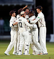 Grant Stewart (C) of Kent is mobbed after bowling George Scott during the County Championship Division 2 game between Kent and Middlesex at the St Lawrence Ground, Canterbury, on June 25, 2018