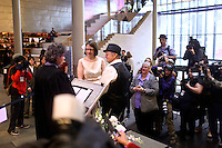 Media surrounds a same sex couple at City Hall in Seattle, WA on Sunday, December 9. Washington state recently passed legistlation that grants same sex couples the right to marry.