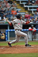 Greenville Drive second baseman Carlos Asuaje #20 swings at a pitch during a game against the  Asheville Tourists at McCormick Field on May 17, 2014 in Asheville, North Carolina. The Tourists defeated the Drive 14-6. (Tony Farlow/Four Seam Images)