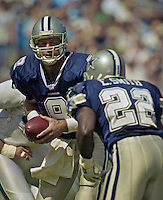 Hall-of-Famer Troy Aikman (8) hands off to Hall-of-Famer Emmit Smith (22) as the Dallas Cowboys beat the Carolina Panthers ar Ericsson Stadium in Charlotte, NC, October 1, 2000.  (Photo by Brian Cleary/www.bcpix.com)