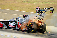Sept. 22, 2012; Ennis, TX, USA: NHRA top fuel dragster driver David Grubnic breaks a fuel line causing a fire during qualifying for the Fall Nationals at the Texas Motorplex. Mandatory Credit: Mark J. Rebilas-US PRESSWIRE