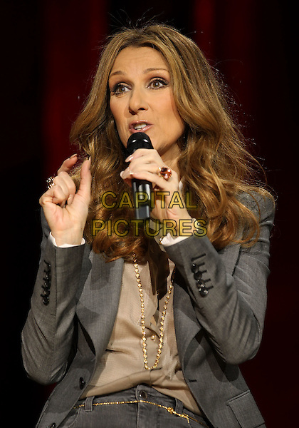 CELINE DION.Celine Dion's Momentous Return To The Colosseum Press Conference At Caesars Palace Resort Casino, Las Vegas, Nevada, USA..March 15th, 2011.half length grey gray jacket gold hands necklace beige shirt blouse microphone .CAP/ADM/MJT.© MJT/AdMedia/Capital Pictures.