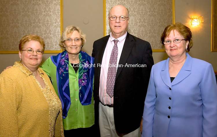 WATERBURY, CT--11 APRIL 2007--041107JS16-Pam Monahan, Development Director at Saint Mary's School, Kathy Upson of Waterbury, Tim Upson of Waterbury and Sue Monaghan, Vice-Principal at Saint Mary's at the Bells of Saint Mary's annual awards dinner Wednesday at the Ponte Club in Waterbury. <br /> Jim Shannon / Republican-American