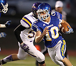 SIOUX FALLS, SD - OCTOBER 11:  Luke Fritsch #10 from O'Gorman scrambles past the Watertown defense in the first quarter of their game Friday night at O'Gorman.  (Photo by Dave Eggen/Inertia)