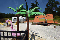 NWA Democrat-Gazette/FLIP PUTTHOFF <br /> Flamingoes and palm tree decor lend a      June 21 2019  nice touch to the vintage camping trailers.