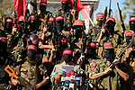 Palestinian militants of the National Resistance brigades, the armed wing of the Democratic Front for the Liberation of Palestine (DFLP) attend a press conference during a military parade against US President Donald Trump's decision to recognise Jerusalem as the capital of Israel, in Gaza city on December 9, 2017. Photo by Ashraf Amra