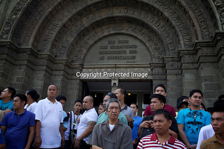Religious Catholics walk out after the morning mass from the Manila Cathedral in the walled city of Intramuros in Manila, Philippines. Photo: Sanjit Das