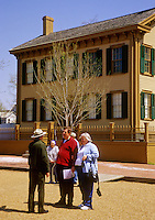 A National Park Ranger talks with tourists in front of Lincoln's Home, in Lincoln's Home National Historic Site in Springfield, Illinois