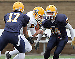 SIOUX FALLS, SD - MAY 4: Darren Niklason #8 from Augustana's offense looks to slip past the defenses' Chad Curry #17 and Justin Brown #14 during the Vikings Spring Game Saturday morning at Kirkeby-Over Stadium on the Augustana College Campus. (Photo by Dave Eggen/Inertia)