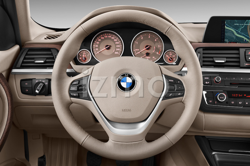 Steering wheel view of a 2012 - 2014 BMW 3-Series 320d Modern 4 Door Sedan.