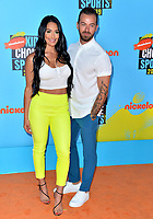 SANTA MONICA, USA. July 11, 2019: Artem Chigvintsev & Nikki Bella at Nickelodeon's Kids' Choice Sports Awards 2019 at Barker Hangar.<br /> Picture: Paul Smith/Featureflash