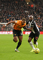 Wolverhampton Wanderers' Adama Traore under pressure from  Newcastle United's Jetro Willems <br /> Photographer Lee Parker/CameraSport<br /> <br /> The Premier League - Wolverhampton Wanderers v Newcastle United - Saturday 11th January 2020 - Molineux - Wolverhampton<br /> <br /> World Copyright © 2020 CameraSport. All rights reserved. 43 Linden Ave. Countesthorpe. Leicester. England. LE8 5PG - Tel: +44 (0) 116 277 4147 - admin@camerasport.com - www.camerasport.com