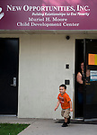 WATERBURY, CT-3 July 2014-070314EC07--   Dennis Nunez, 4, and his grandmother Irma Lopez, walk out of the former New Opportunities program along North Main Street in Waterbury. It is being taken over by Community Development Institute. Erin Covey Republican-American