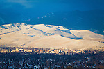 The Missoula, Montana valley in winter with the north hills covered with snow and lit by sunlight