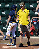 Michigan Wolverines Softball outfielder Lyndsay Doyle (11) and head coach Carol Hutchins during a game against the Bethune-Cookman on February 9, 2014 at the USF Softball Stadium in Tampa, Florida.  Michigan defeated Bethune-Cookman 12-1.  (Copyright Mike Janes Photography)