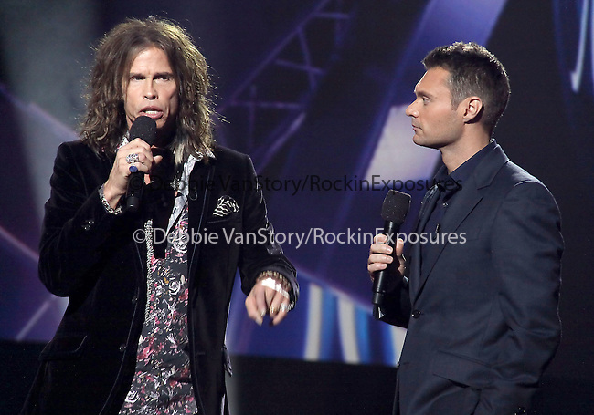 Steven Tyler and Ryan Seacrest  at The AMERICAN IDOL Season Ten judges' panel Announcement held at The Forum in Los Angeles, California on September 22,2010                                                                               © 2010 Hollywood Press Agency
